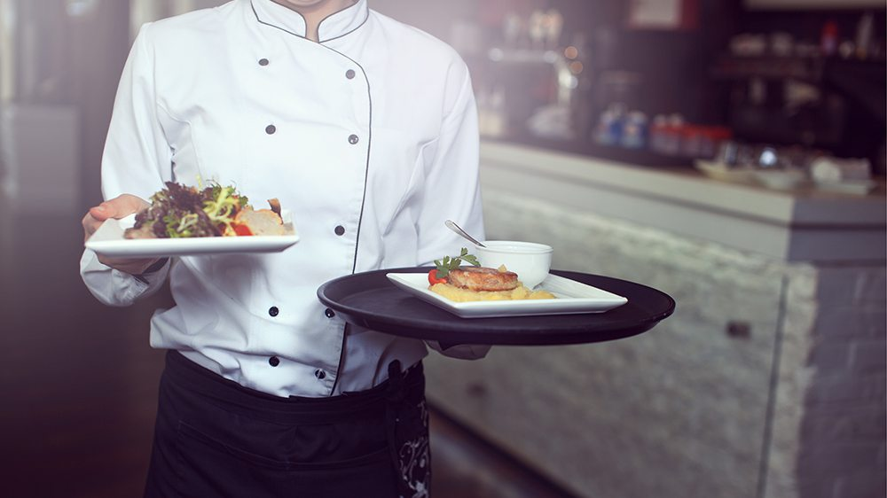Server carrying fresh food from the kitchen