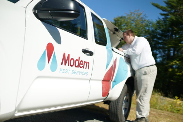 Modern Pest truck and service professional