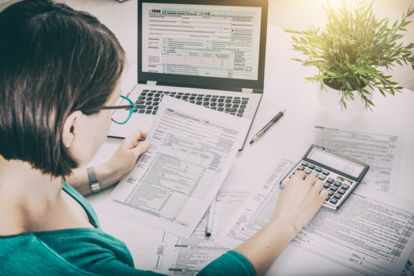 A woman does her taxes